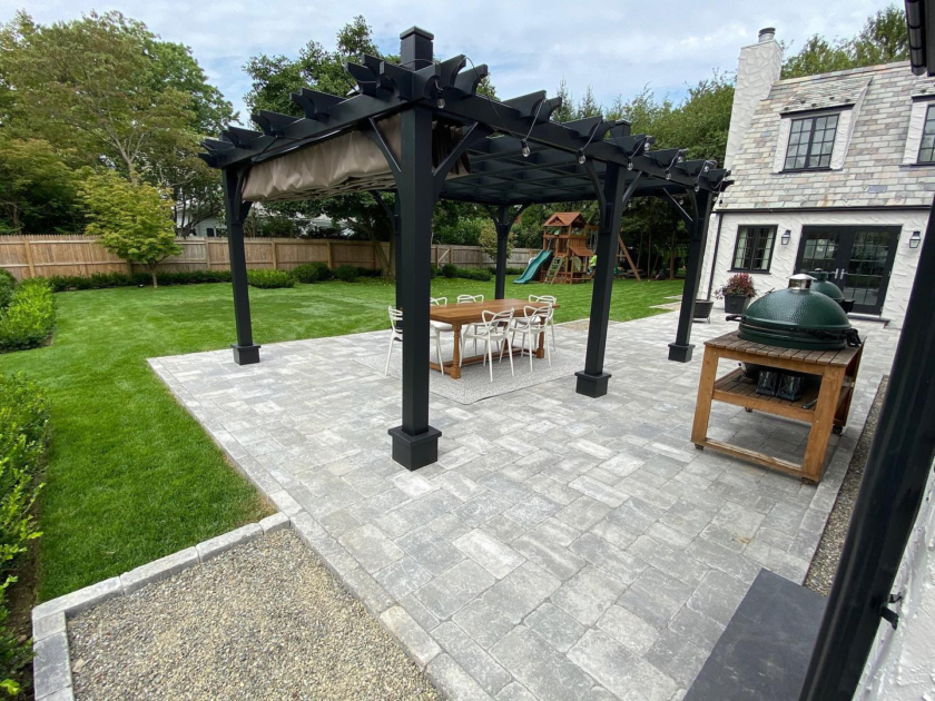 outdoor patio with gril and black gazebo